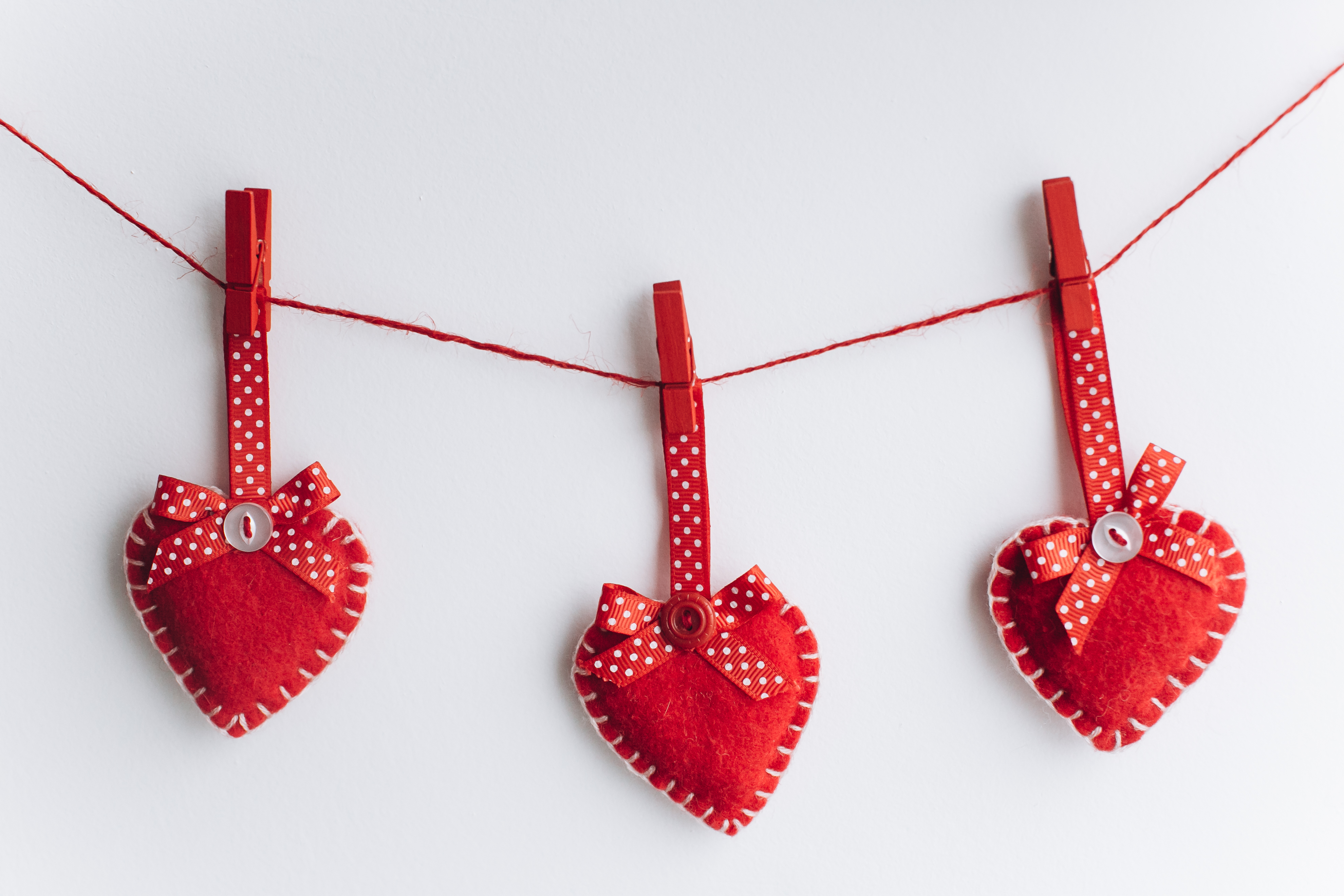 Valentine's Day Concept. Decorative hearts with keys on a white